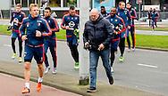 ROTTERDAM - Dirk Kuyt feyenoord coach  Giovanni van Bronckhorst loopt onder begeleiding van een beveiliger samen met  Jan Wouters naar het trainingsveld varkensoord . copyright robin utrecht