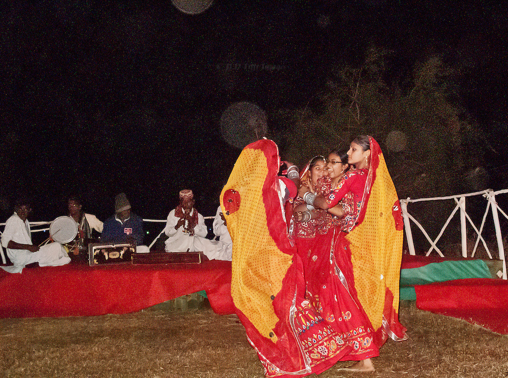 Five young women dancers fuse into one during a moment in their traditional dance.
