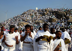 60611493 <br /> Muslim pilgrims pray on Mount Arafat in Mecca of Saudi Arabia, Oct. 17, 2013. The five-day haj officially ends on Thursday. Some 2 million Muslim pilgrims, of which 1.38 million are foreigners, performed this years haj, Thursday October. 17, 2013. Picture by imago /  i-Images<br /> UK ONLY