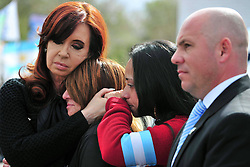 Argentina's President Cristina Fernandez (L) comforts relatives of Malvinas (Falklands) War's veterans during the commemoration ceremony of the 31st anniversary of the Malvinas War at the Monument to the Fallen in Malvinas Square in Madryn Port, province of Chubut, Argentina,  April 2, 2013.. Photo by Imago / i-Images...UK ONLY..