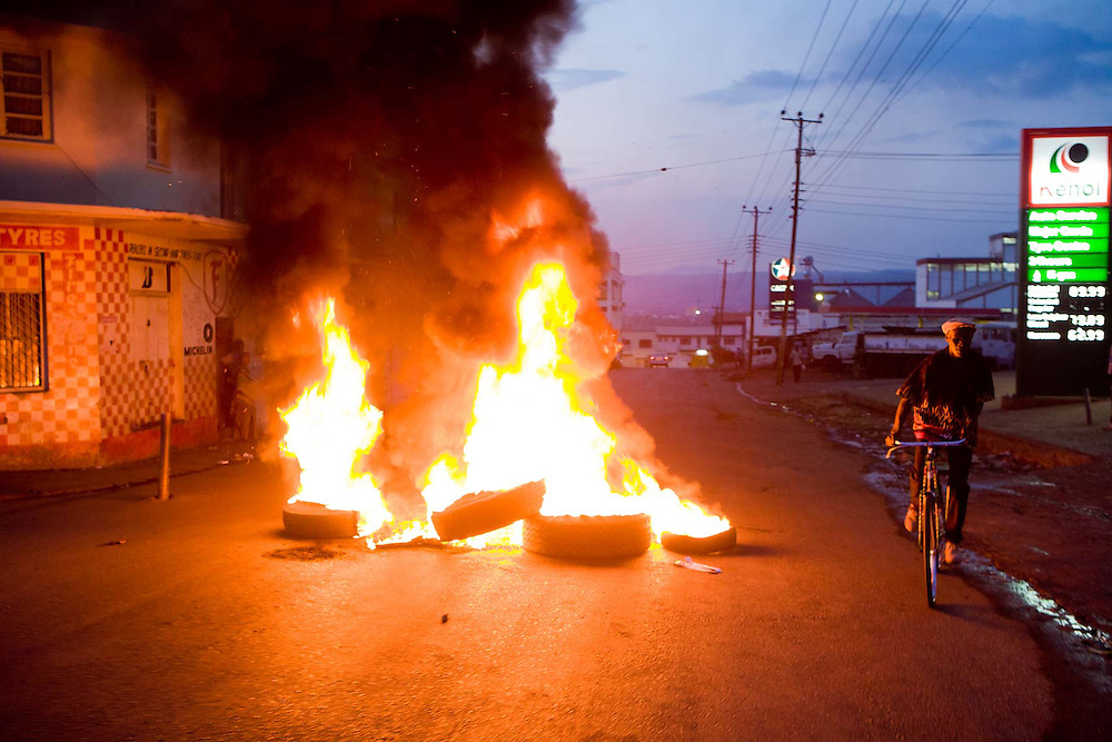 Burning road blocks in Kisumu, Kenya.