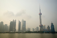 A view of the Oriental Pearl Tower, the tallest tower in Asia, on the Pudong side of Shanghai, China.  Air pollution, particularly from SO2 is a major problem in Shanghai.  Most of the pollution comes from coal-burning smoke and vehicle emissions.
