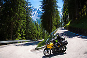 Suzuki Vstrom motorcycle on The Stelvio Pass, Passo dello Stelvio, Stilfser Joch, route to Trafio in The Alps, Italy