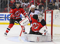 Feb 27, 2014; Newark, NJ, USA; New Jersey Devils goalie Cory Schneider (35) makes a glove save during the second period of their game against the Columbus Blue Jackets at Prudential Center.