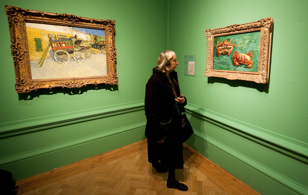London, England January 19th  A member of the public admires Two Crabs next to The Tarascon Diligence both by Van Gogh  at the Royal Academy of Art in London on January 19th 2010.  The real Van Goh the artist and his letters opens at The Royal Academy of Arts in London...***Agreed Fee's Apply To All Image Use***.Marco Secchi /Xianpix. tel +44 (0) 771 7298571. e-mail ms@msecchi.com .www.marcosecchi.com