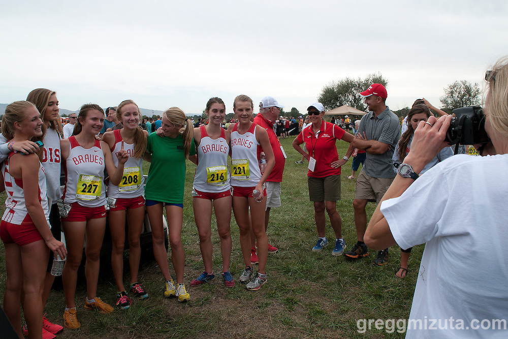Mountain View's Sam McKinnon joins in with the Boise team (L to R: Jackie Loutzenheiser, Sienna White, Emily Hamlin, Sam McKinnon, Madison Lung, Hanna Orton, Coach Dave Mill, Coach Cathy Olson) for post race pictures following the girl's elite race at the Bob Firman Invitational at Eagle Island State Park in Eagle, Idaho on September 21, 2013.