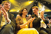 Liberal Democrats<br /> Autumn Conference 2011 <br /> at the ICC, Birmingham, Great Britain <br /> <br /> 17th to 21st September 2011 <br /> <br /> Rt Hon Michael Moore - Scottish Secretary of State <br /> Miriam Gonzalez Durantez &amp; Rt Hon Danny Alexander MP <br /> watching Nick Clegg's speech <br /> <br /> Rt Hon Nick Clegg MP<br /> Leader of the Liberal Democrats<br /> Deputy Prime Minister<br /> Speech <br /> <br /> Photograph by Elliott Franks