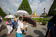 Wat Phra Keo and Grand Palace. Tourists taking souvenir photos.