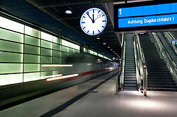 German ICE Express train travelling through Potsdamer Platz railway station Berlin 2009
