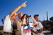 Victor Emanuel points out a bird to Dan Chiaravalli, Roger Tory Peterson and Dan Smyth behind, Tucson, Arizona..Media Usage:.Subject photograph(s) are copyrighted Edward McCain. All rights are reserved except those specifically granted by McCain Photography in writing...McCain Photography.211 S 4th Avenue.Tucson, AZ 85701-2103.(520) 623-1998.mobile: (520) 990-0999.fax: (520) 623-1190.http://www.mccainphoto.com.edward@mccainphoto.com.