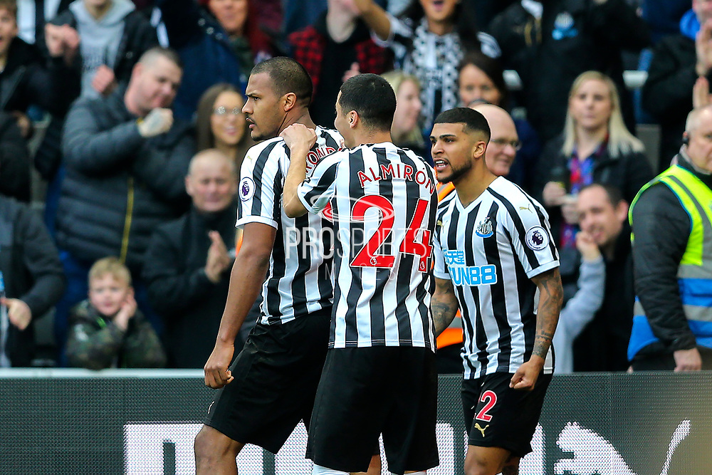 Jose Salomon Rondon (#9) of Newcastle United celebrates Newcastle United's first goal (1-0) with Miguel Almiron (#24) of Newcastle United and DeAndre Yedlin (#22) of Newcastle United during the Premier League match between Newcastle United and Huddersfield Town at St. James's Park, Newcastle, England on 23 February 2019.