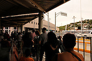 Border crossers wait in Nogales, Sonora, Mexico, to pass through customs to enter the United States at Nogales, Arizona.