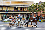A horse drawn carriage on Avenida Menendez in St. Augustine, Florida. St Augustine is the oldest city in America.
