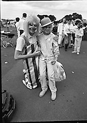 """Guinness Family Day At The Iveagh Gardens. (R83)..1988..02.07.1988..07.02.1988..2nd  July 1988..The family fun day for Guinness employees and their families took place at the Iveagh Gardens today. Top at the bill at the event were """"The Dubliners"""" who treated the crowd to a performance of all their hits. Ireland's penalty hero from Euro 88, Packie Bonner, was on hand to sign autographs for the fans...Clowning around in the park,this young lady is pictured meeting one of the clowns during the family day out."""