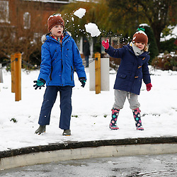© Licensed to London News Pictures. 11/12/2017. Amersham, UK. Edward (6) and and Zoe (4) play in the snow in the town of Amersham in Buckinghamshire. Transport is being heavily affected across parts of the islands and southern England with British Airways cancelling 30 flights before 10am this morning. Photo credit: Tom Nicholson/LNP