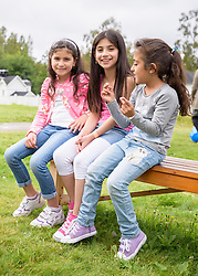 """13 August 2016, Norrbyskär, Umeå, Sweden: Recently arrived refugee children enjoying their day at the Kul-Tur Fest (""""Culture Festival""""). The event, which attracted hundreds of people, set out to offer a meeting place for Swedish culture and new forms of cultural expression, and featured baking competitions, dance workshops, book discussions, fingernail painting and music, among other things."""