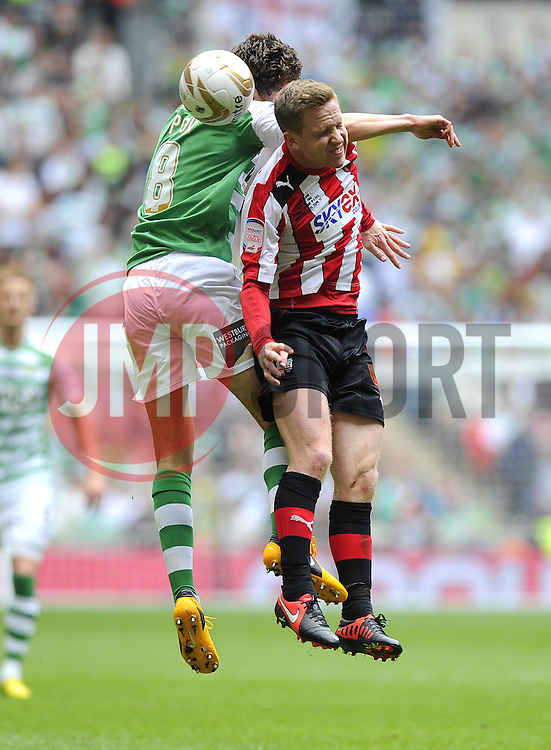 Yeovil Town's Edward Upson battles for the high ball with Brentford's Harlee Dean - Photo mandatory by-line: Joe Meredith/JMP - Tel: Mobile: 07966 386802 19/05/2013 - SPORT - FOOTBALL - LEAGUE 1 - PLAY OFF - FINAL - Wembley Stadium - London - Brentford V Yeovil Town