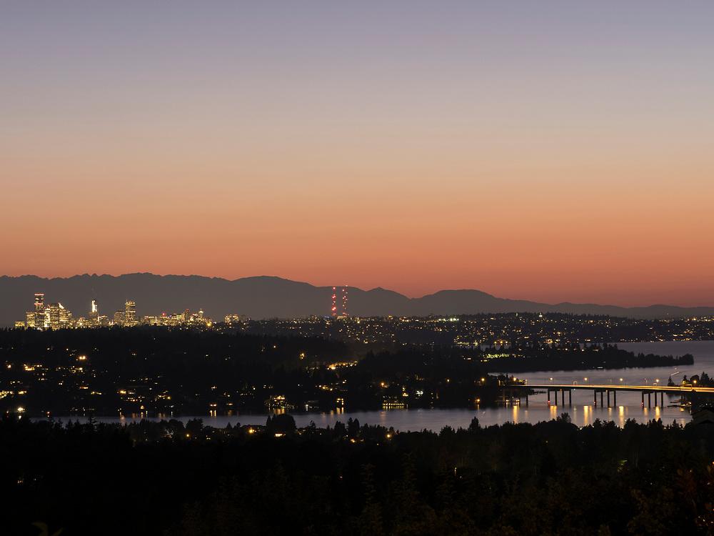 United States, Washington, Seattle skyline, Olympic Mountains and Lake Washington at sunset, viewed from Bellevue