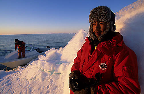 Canada, Nunavut Territory, Adam, a local Inuit from the town of Igloolik, also a search guide for walrus on the ice floes.