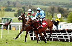 Magic Of Light (left) ridden by jockey Ryan Treacy on the way to winning the Martinstown Opportunity Series Final Handicap Hurdle during day two of the Punchestown Festival in Naas, Co. Kildare.