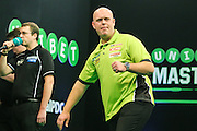 Michael van Gerwen wins a leg in his quarter final match against Mensur Suljovic during the PDC Unibet Masters 2017 at Arena MK, Milton Keynes, United Kingdom on 29 January 2017. Photo by Shane Healey.