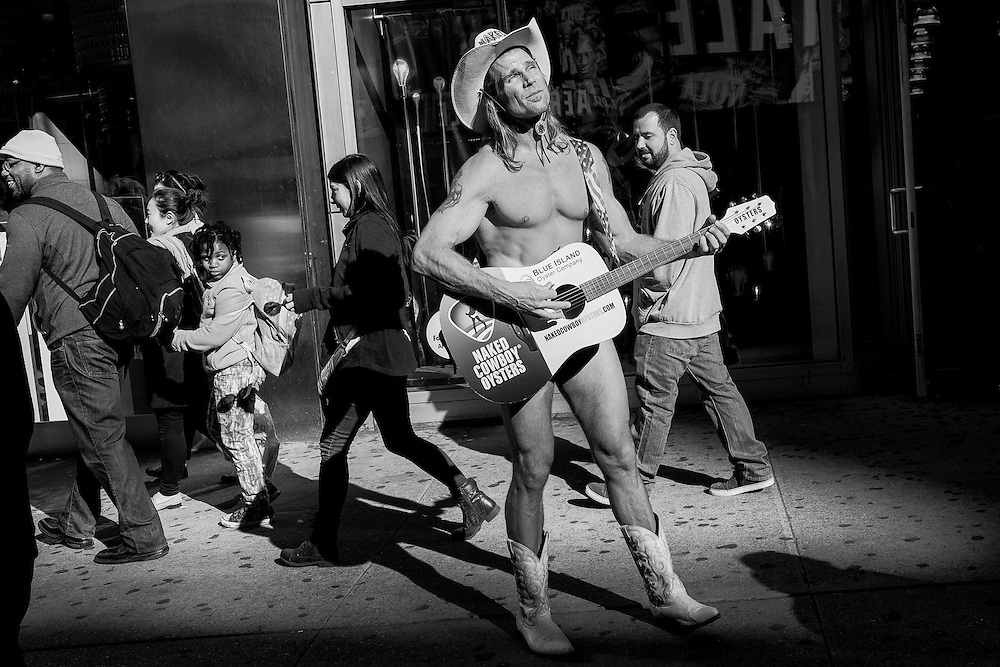 Robert John Burck, better known as the Naked Cowboy, is an American street performer whose pitch is on New York City's Times Square. He wears only cowboy boots, a hat, and briefs, with a guitar strategically placed to give the illusion of nudity.<br />