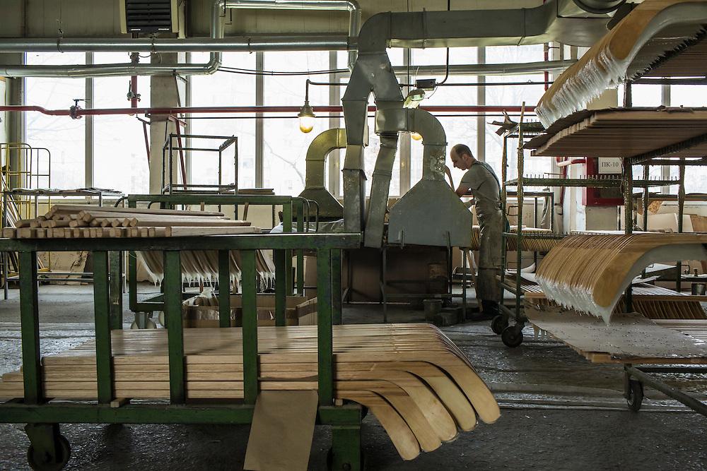 MUKACHEVO, UKRAINE - FEBRUARY 25, 2016: A worker at the Fischer-Mukachevo factory produces hockey sticks in Mukachevo, Ukraine. The plant fabricates skis as well as hockey sticks, many of which are produced for export. CREDIT: Brendan Hoffman for The New York Times