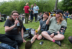 "© Licensed to London News Pictures. 25/05/2019. Bristol, UK. STEVE and CHERYL (middle and right, no surnames given) with a cans of cider at a ""drink-in"" protest, organised by Bristol Momentum Youth, held in Bristol's Castle Park against fines under a Public Space Protection Orders (PSPOs) now being implemented by Bristol City Council which are used to ban alcohol drinking in certain areas. Though most of the alcohol in public bans have been in place since late 2017, they weren't actively enforced until this year when contractor 3GS took over the council contract for litter and other rules enforcement in outside spaces from previous contractor Kingdom. The PSPO rule states that: ""No person in the restricted area shall be in possession of any opened or unsealed bottle or container of alcohol"". The fines can be up to £100 and protestors say it will disproportionately affect the least well off in the community who are also likely be targeted more with the fines in the first place, and is another step in eroding the use of public space. Photo credit: Simon Chapman/LNP."
