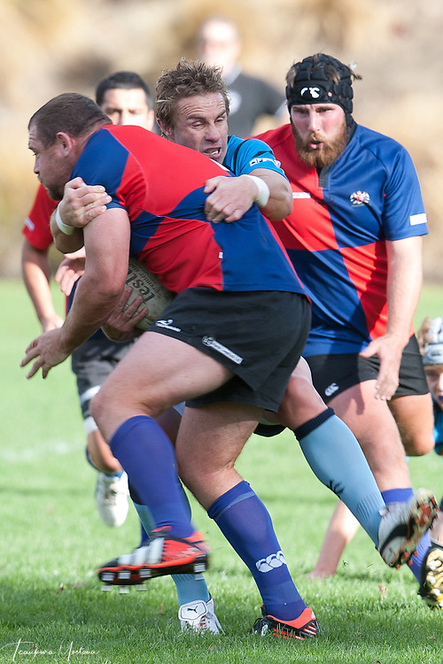 Tony Woodcock of Maniototo Maggots is tackled by Justin Marshall of Wakatipu during the White Horse Cup rugby clash between Wakatipu and Maniototo at Queenstown Recreation Ground, Queenstown, New Zealand, Saturday, April 27th, 2013. Credit:Teaukura Moetaua / Media Sport