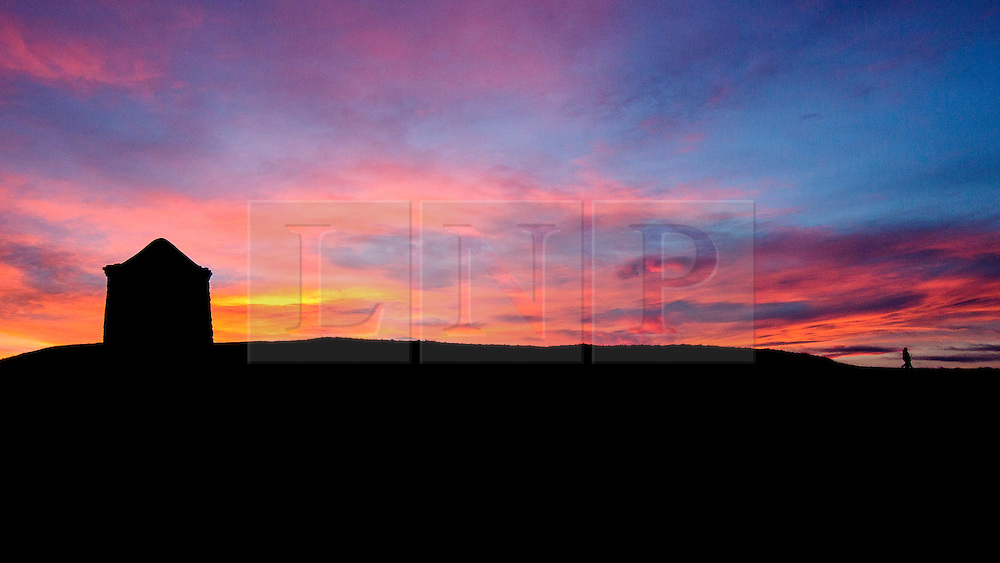 © Licensed to London News Pictures. 21/12/2014.  Burton Dassett Hills, Warwickshire.  The sun sets over Warwickshire this evening at the end of the winter solstice.  The December solstice marks the longest night and shortest day of the year.  Photo credit : Alison Baskerville/LNP