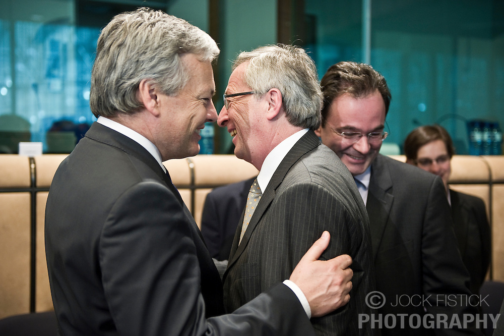 Jean-Claude Juncker, Luxembourg's prime minister, and president of the Eurogroup, center, is greeted by Didier Reynders, Belgium's finance minister, left, and George Papaconstantinou, Greece's finance minister, during the meeting of European Union finance ministers in Brussels, Belgium, on Monday, May 17, 2010.  (Photo © Jock Fistick)