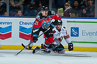 KELOWNA, CANADA - OCTOBER 13: Cal Foote #25 of the Kelowna Rockets checks a player of the Calgary Hitmen during first period on October 13, 2017 at Prospera Place in Kelowna, British Columbia, Canada.  (Photo by Marissa Baecker/Shoot the Breeze)  *** Local Caption ***
