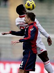Bari (BA), 13-02-2011 ITALY - Italian Soccer Championship Day 25 - Bari VS Genoa..Pictured:Criscito (GE) Okaka (BA).Photo by Giovanni Marino/OTNPhotos . Obligatory Credit