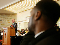 Democratic Presidential Candidate Howard Dean, left speaks during mass at the Holy Redeemer Institutional Church of God in Christ on a campaign stop in Milwaukee WI Sunday Feb. 1, 2004........