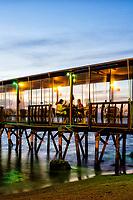 Trapiche do restaurante Ostradamus, no Ribeirão da Ilha. Florianópolis, Santa Catarina, Brasil. / Pier of Ostradamus Restaurant, at Ribeirao da Ilha Beach. Florianopolis, Santa Catarina, Brazil.