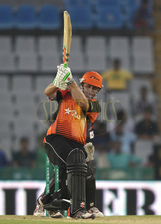 Craig Simmons of the Perth Scorchers hits over the top for six during match 4 of the Oppo Champions League Twenty20 between the Dolphins and the Perth Scorchers held at the Punjab Cricket Association Stadium, Mohali, India on the 20th September 2014<br /> <br /> Photo by:  Shaun Roy / Sportzpics/ CLT20<br /> <br /> <br /> Image use is subject to the terms and conditions as laid out by the BCCI/ CLT20.  The terms and conditions can be downloaded here:<br /> <br /> http://sportzpics.photoshelter.com/gallery/CLT20-Image-Terms-and-Conditions-2014/G0000IfNJn535VPU/C0000QhhKadWcjYs