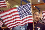 "04 JULY 2009 -- PHOENIX, AZ:  Corporal TUNG NGUYEN, US Marine Corps, originally from Vietnam, waves an American flag after being naturalized a US citizen at a naturalization ceremony in Phoenix, AZ, July 4. U.S. Citizenship and Immigration Services and South Mountain Community College in Phoenix, AZ, hosted the 21st annual ""Fiesta of Independence"" Saturday, July 4. More than 180 people from 58 countries took the US Oath of Citizenship and became naturalized US citizens. The ceremony was one of dozens of similar ceremonies held across the US this week. USCIS said more than 6,000 people were naturalized US citizens during the week.  Photo by Jack Kurtz / ZUMA Press"