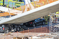 New pedestrian bridge at south Florida college collapses leaving vehicles trapped underneath and six people dead on Thursday, March 15, 2018. <br />