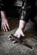 man's hands with an old, rusty knife
