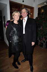 GARY WILLCOX and his wife JO MALONE at the Linley Christmas Party and launch of the book 'Star Pieces' by David Linley, Charles Cator and Helen Chislett held at Linley, 60 Pimlico Road, London on 18th November 2009.