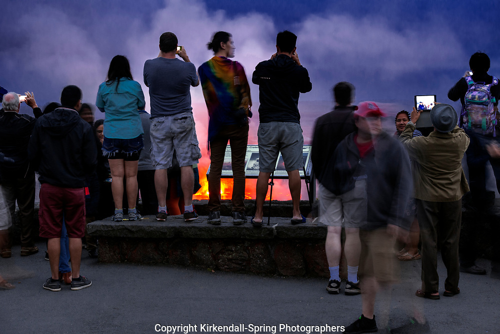 HI00249-00...HAWAI'I - People viewing the lava glowing in the Halema'uma'u Crater from the Jaggar Museum in Volcanoes National Park on the island of Hawai'i.
