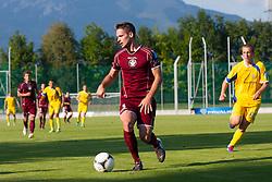 Roskar Marko of NK Triglav & Husmani Zeni of NK Domzale during football match between NK Triglav Kranj and NK Domzale, 5th Round of Prva Liga, on 12 August, 2012, in Sportni center, Kranj, Slovenia. (Photo by Grega Valancic / Sportida)