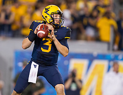 Sep 5, 2015; Morgantown, WV, USA; West Virginia Mountaineers quarterback Skyler Howard drops back to pass during the first half against the Georgia Southern Eagles at Milan Puskar Stadium. Mandatory Credit: Ben Queen-USA TODAY Sports