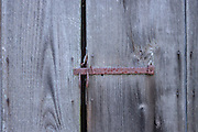 weathered wooden door with latch