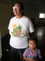 Mother and child squatters in the Wounded Knee Memorial building, Pine Ridge Reservation, SD, 2005.