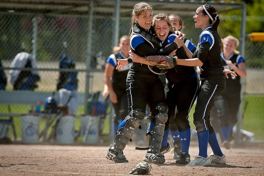 JEROME A. POLLOS..Timberline High's Kendra Nagy, left, Erin Keen and Jenna Bice celebrate their 7-3 win over Coeur d'Alene High in the 5A state championship game Saturday in Coeur d'Alene.