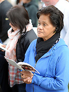 Sonia Miguel of San Jose, California prays during the Papal Mass celebrated by Pope Francis Benjamin Franklin Parkway Sunday September 27, 2015 in Philadelphia, Pennsylvania.  (Photo By William Thomas Cain)