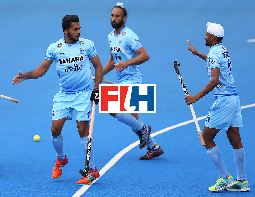 LONDON, ENGLAND - JUNE 25:  Harmanpreet Singh of India celebrates scoring their teams first goal with teammates during the 5th/6th place match between India and Canada on day nine of the Hero Hockey World League Semi-Final at Lee Valley Hockey and Tennis Centre on June 25, 2017 in London, England.  (Photo by Steve Bardens/Getty Images)