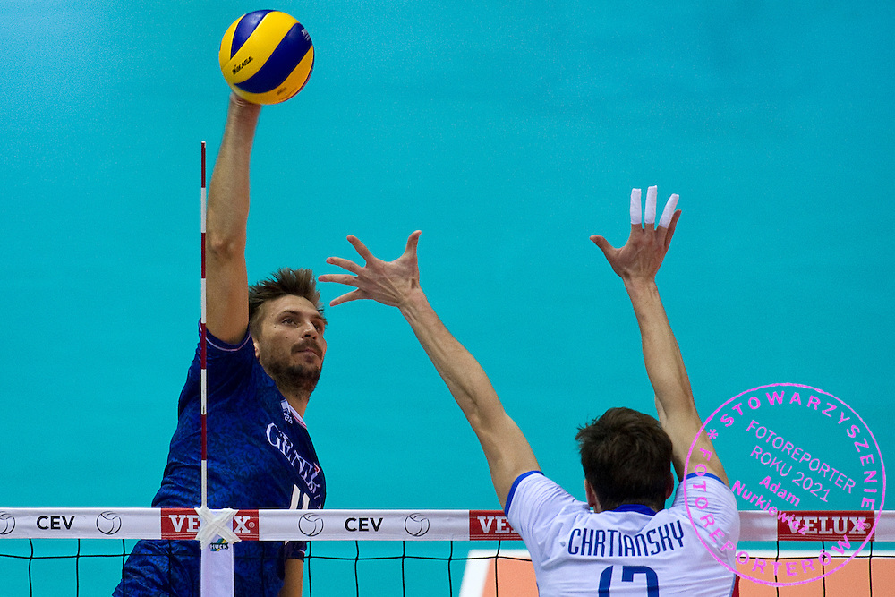 (L) Antonin Rouzier from France attacks against (R) Stefan Chrtiansky Jr from Slovakia during the 2013 CEV VELUX Volleyball European Championship match between France and Slovakia at Ergo Arena in Gdansk on September 20, 2013.<br /> <br /> Poland, Gdansk, September 20, 2013<br /> <br /> Picture also available in RAW (NEF) or TIFF format on special request.<br /> <br /> For editorial use only. Any commercial or promotional use requires permission.<br /> <br /> Mandatory credit:<br /> Photo by © Adam Nurkiewicz / Mediasport