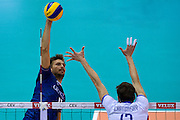 (L) Antonin Rouzier from France attacks against (R) Stefan Chrtiansky Jr from Slovakia during the 2013 CEV VELUX Volleyball European Championship match between France and Slovakia at Ergo Arena in Gdansk on September 20, 2013.<br /> <br /> Poland, Gdansk, September 20, 2013<br /> <br /> Picture also available in RAW (NEF) or TIFF format on special request.<br /> <br /> For editorial use only. Any commercial or promotional use requires permission.<br /> <br /> Mandatory credit:<br /> Photo by &copy; Adam Nurkiewicz / Mediasport
